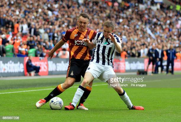 Bradford City's Tony McMahon and Millwall's Shane Ferguson battle for the ball during the Sky Bet League One play off final at Wembley Stadium London
