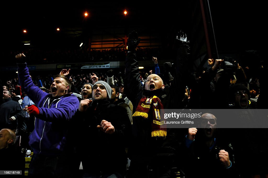 Bradford fans celebrate after Garry Thompson of Bradford scores the opening goal during the Capital One Cup quarter final match between Bradford City and Arsenal at the Coral Windows Stadium, Valley Parade on December 11, 2012 in Bradford, England.