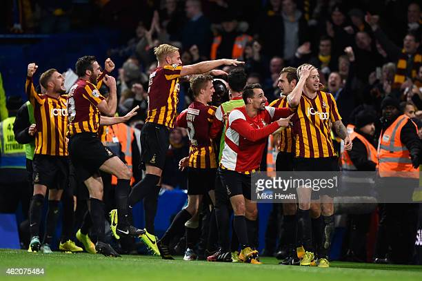 Bradford players celebrate following their team's 42 victory during the FA Cup Fourth Round match between Chelsea and Bradford City at Stamford...