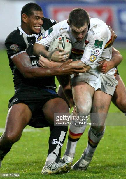 Bradford's Ben Harris is tackled by St Helens's Leon Pryce during the engage Super League match at Grattan Stadium Bradford