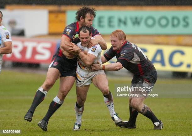 Bradford's Ben Jefferies is tackled by St Helens's Josh Perry and James Graham during the engage Super League match at the Odsal Stadium Bradford