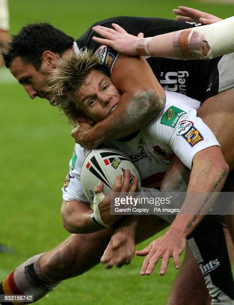 Bradford's Glen Morrison is tackled by St Helens's Lee Gilmour during the engage Super League match at Grattan Stadium Bradford