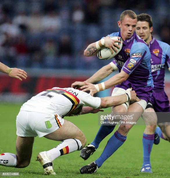 Bradford's Glenn Morrison's tries to tackle Huddersfield's Kevin Brown during the engage Super League match at the Galpharm Stadium Huddersfield
