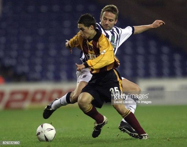 Bradford's Mark Danks is challenged by Albions Larus Sigurdsson during their FA Cup Third Round match at the Hawthorns ground West Bromwich THIS...