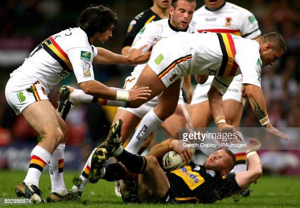 Bradford's Matt Cook and Terry Newton tackle Leeds' Jamie Thackray during the Engage Super League match at the Millennium Stadium Cardiff
