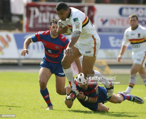 Bradford's Tame Tupou jumps from the tackle of Wakefield's Duncan McGilvray during their engage Super League match at Odsal Stadium Bradford