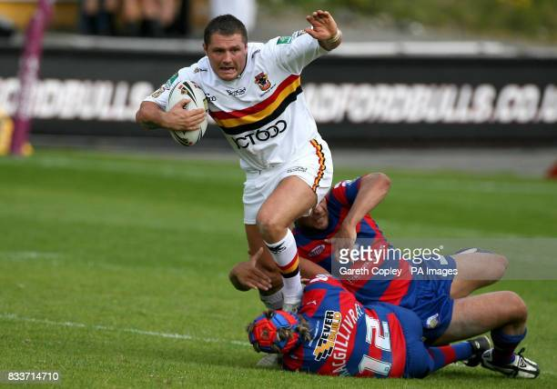 Bradford's Terry Newton jumps through the tackles of Wakefield's Olivier Elima and Duncan McGilvray during their engage Super League match at Odsal...