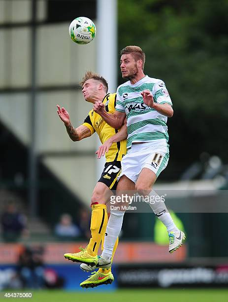 Bradley Abbott of Barnsley battles for the ball with Sam Foley of Yeovil Town during the Sky Bet League One match between Yeovil Town and Barnsley at...