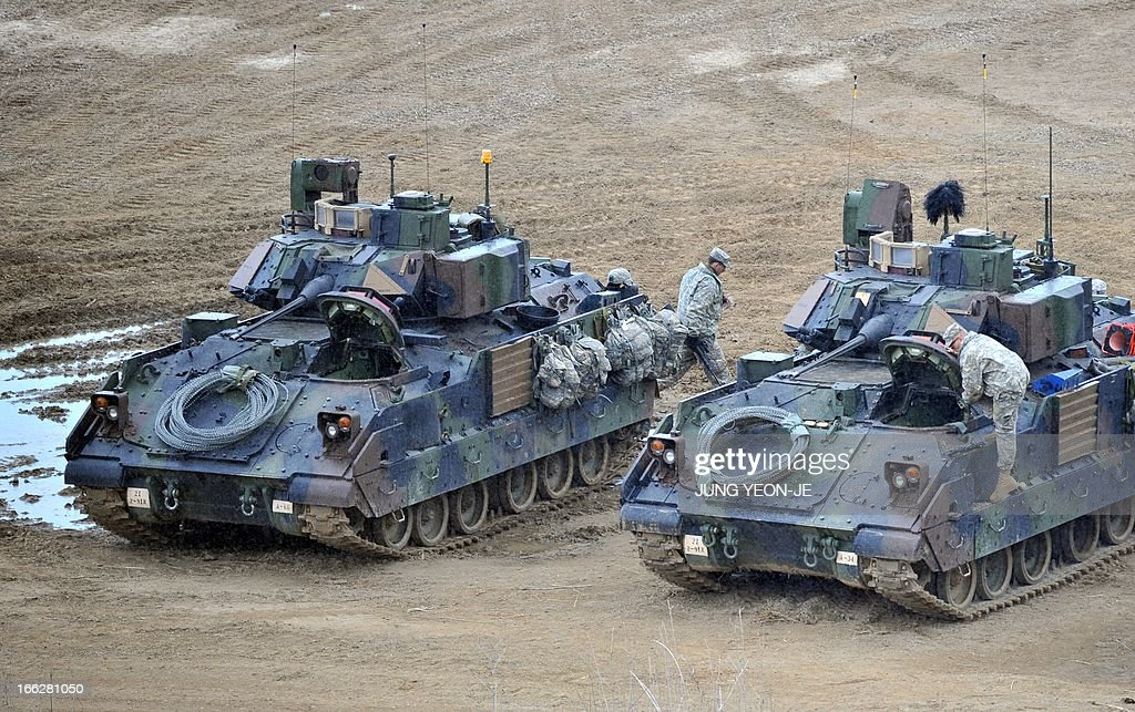 US Bradley armored vehicles are parked at a military training field in the border city of Yeoncheon, northeast of Seoul, on April 11, 2013. The United States has warned North Korea it is skating a 'dangerous line' with an expected missile launch that could start a whole new cycle of escalating tensions in a region already on a hair-trigger.
