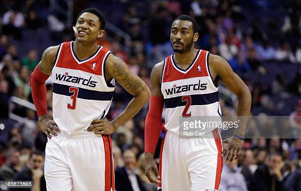 Bradley Beal and and John Wall of the Washington Wizards talk during a free throw in the first half against the Phoenix Suns at Verizon Center on...