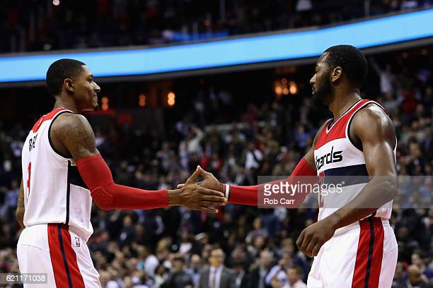 Bradley Beal and John Wall of the Washington Wizards celebrate in the fourth quarter of the Wizards 9592 win at Verizon Center on November 4 2016 in...