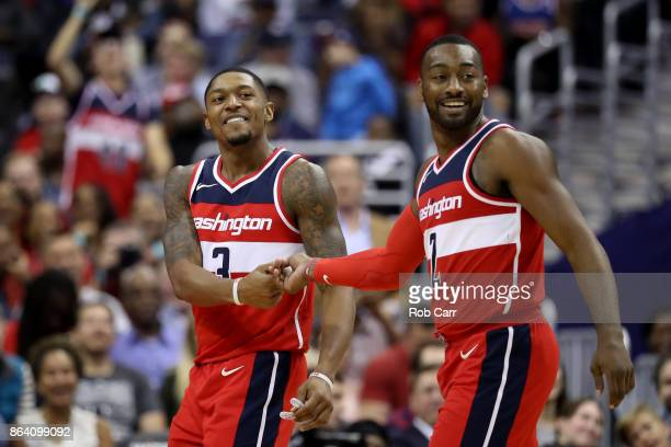 Bradley Beal and John Wall of the Washington Wizards celebrate in the second half against the Detroit Pistons at Capital One Arena on October 20 2017...