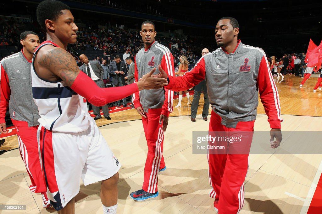 Bradley Beal #3 and John Wall #2 of the Washington Wizards during pre-game announcements against the Atlanta Hawks during the game at the Verizon Center on January 12, 2013 in Washington, DC.