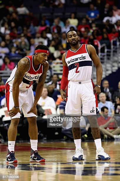 Bradley Beal and John Wall of the Washington Wizards talk in the first half against the Atlanta Hawks at Verizon Center on March 23 2016 in...