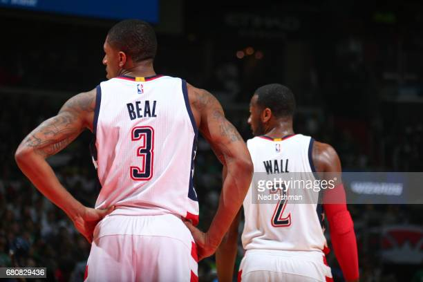Bradley Beal and John Wall of the Washington Wizards walk up the court in Game Four of the Eastern Conference Semifinals against the Boston Celtics...