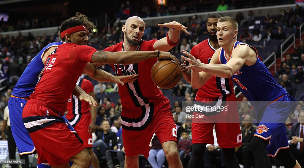 <a gi-track='captionPersonalityLinkClicked' href=/galleries/search?phrase=Bradley+Beal&family=editorial&specificpeople=7640439 ng-click='$event.stopPropagation()'>Bradley Beal</a> #3 and <a gi-track='captionPersonalityLinkClicked' href=/galleries/search?phrase=Marcin+Gortat&family=editorial&specificpeople=589986 ng-click='$event.stopPropagation()'>Marcin Gortat</a> #13 of the Washington Wizards and Kristaps Porzingis #6 of the New York Knicks go after a loose ball in the first half at Verizon Center on March 19, 2016 in Washington, DC.