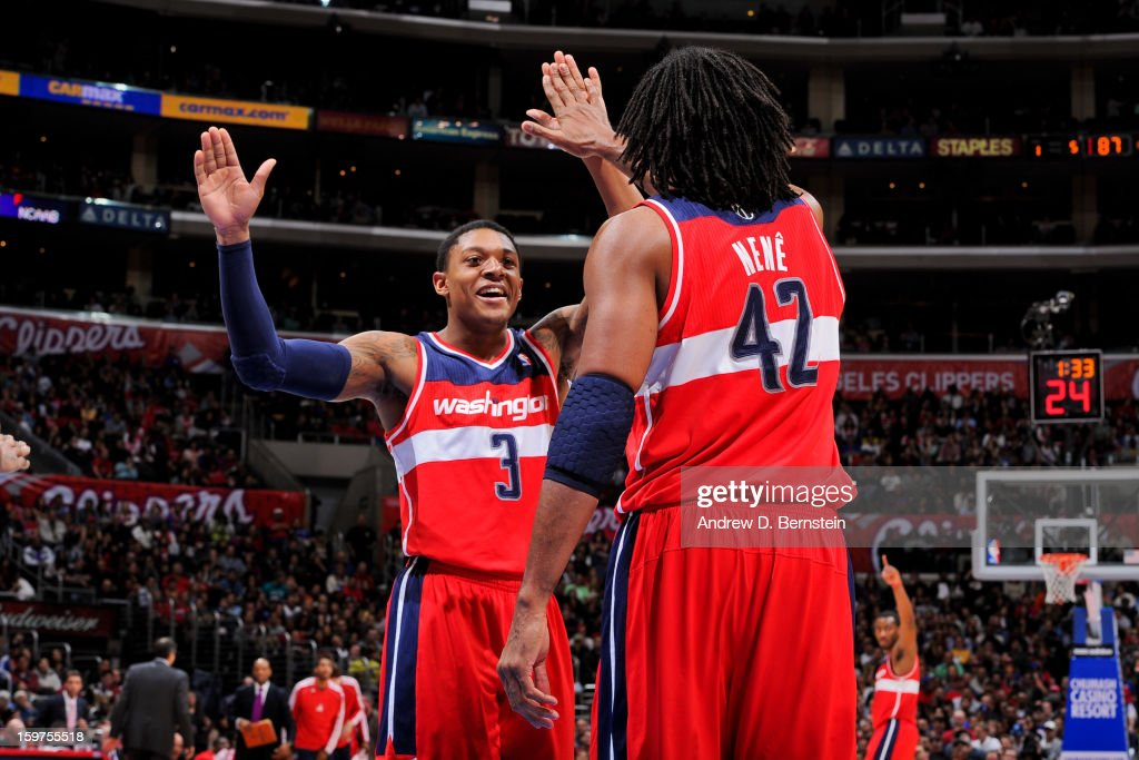 Bradley Beal #3 and Nene #42 of the Washington Wizards celebrate while playing the Los Angeles Clippers at Staples Center on January 19, 2013 in Los Angeles, California.