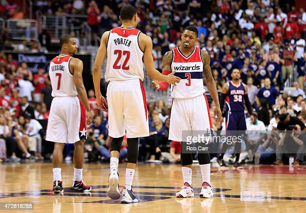 Bradley Beal and Otto Porter Jr #22 of the Washington Wizards celebrate against the Atlanta Hawks during Game Three of the Eastern Conference...