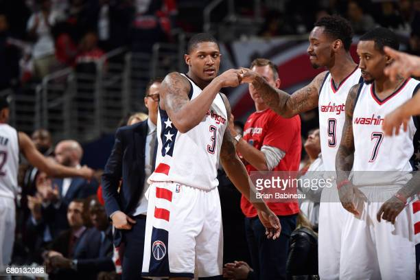 Bradley Beal and Sheldon McClellan of the Washington Wizards fist bump each other during the game against the Boston Celtics during Game Four of the...