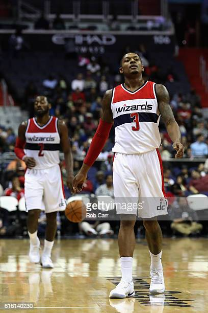 Bradley Beal of the Washington Wizards and John Wall look on in the second half against the Toronto Raptors at Verizon Center on October 21 2016 in...