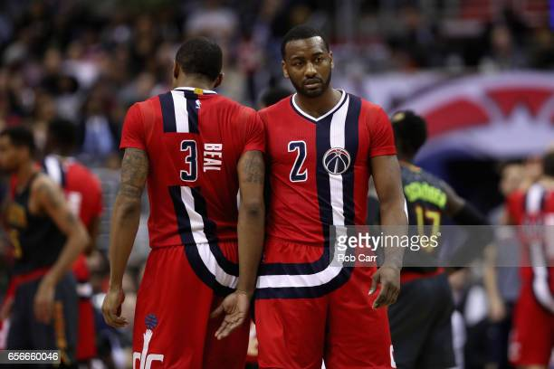 Bradley Beal of the Washington Wizards and John Wall of the Washington Wizards talk on the floor in the second half against the Atlanta Hawks at...