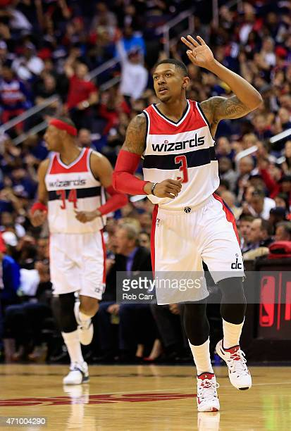 Bradley Beal of the Washington Wizards celebrates after hitting a three pointer against the Toronto Raptors in the first quarter of Game Three of the...