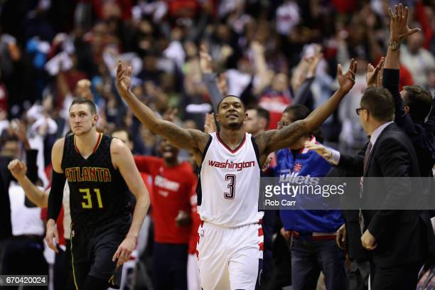 Bradley Beal of the Washington Wizards celebrates in front of Mike Muscala of the Atlanta Hawks after hitting a three pointer in the second half of...