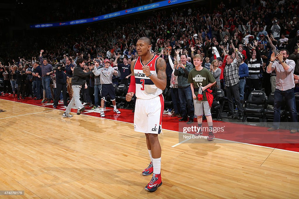 <a gi-track='captionPersonalityLinkClicked' href=/galleries/search?phrase=Bradley+Beal&family=editorial&specificpeople=7640439 ng-click='$event.stopPropagation()'>Bradley Beal</a> #3 of the Washington Wizards celebrates the win against the New Orleans Pelicans during the game at the Verizon Center on February 22, 2014 in Washington, DC.
