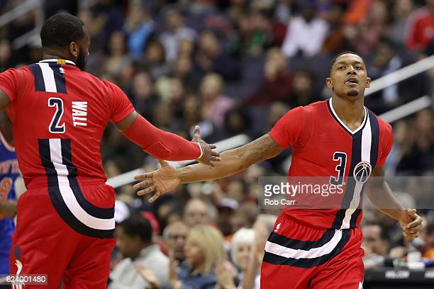 Bradley Beal of the Washington Wizards celebrates with John Wall after hitting a three pointer against the New York Knicks at Verizon Center on...