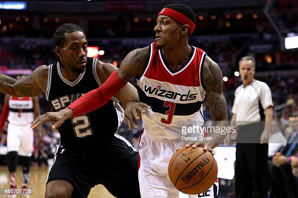 Bradley Beal of the Washington Wizards dribbles past Kawhi Leonard of the San Antonio Spurs during the first half at Verizon Center on November 4...