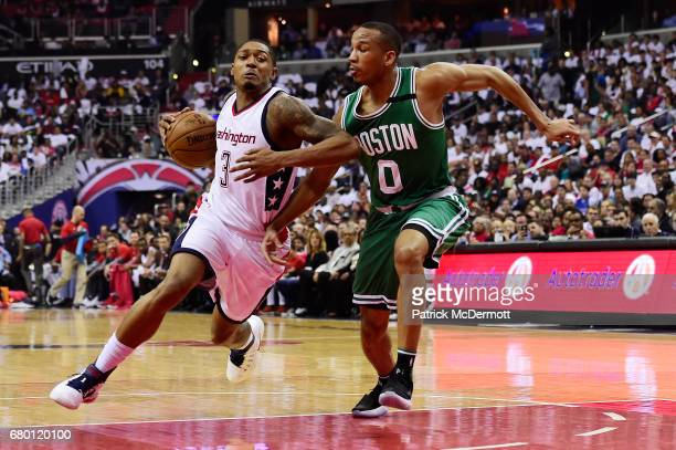 Bradley Beal of the Washington Wizards dribbles the ball against Avery Bradley of the Boston Celtics in the first quarter in Game Four of the Eastern...