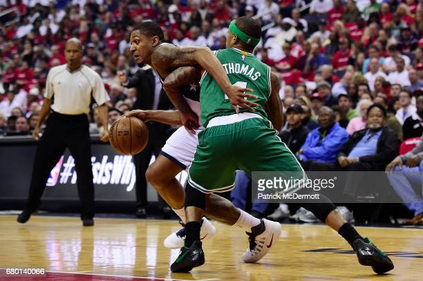 Bradley Beal of the Washington Wizards dribbles the ball against Isaiah Thomas of the Boston Celtics in the first half in Game Four of the Eastern...