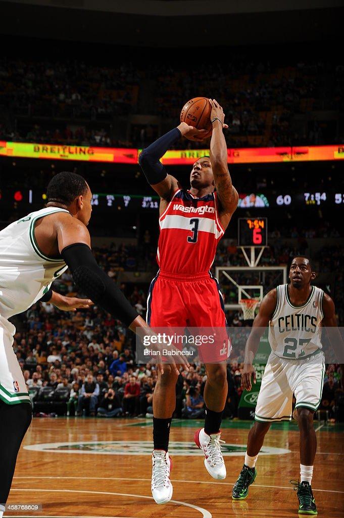 Bradley Beal #3 of the Washington Wizards dribbles the ball against the Boston Celtics on December 21, 2013 at the TD Garden in Boston, Massachusetts.