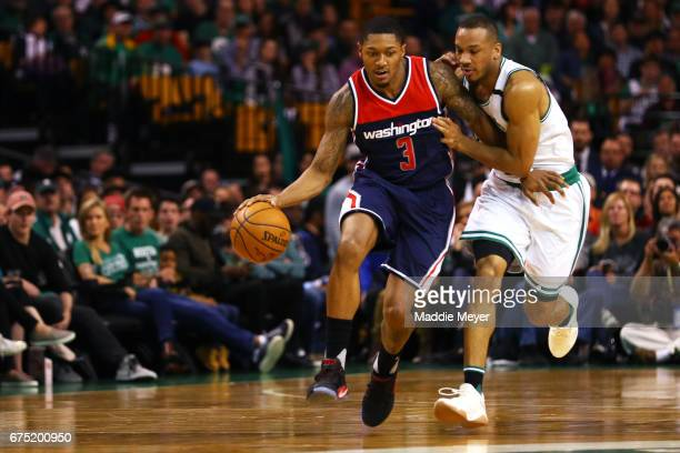 Bradley Beal of the Washington Wizards drives against Avery Bradley of the Boston Celtics during the second quarter of Game One of the Eastern...