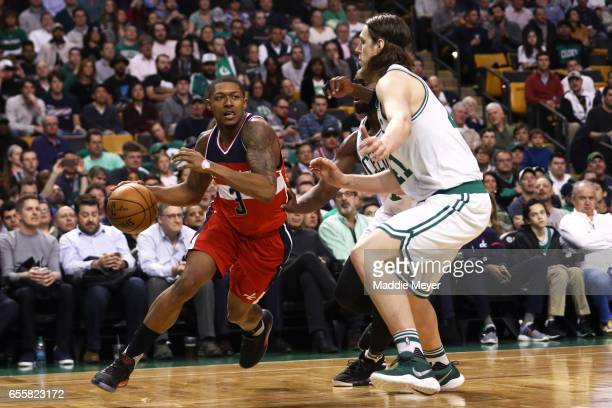 Bradley Beal of the Washington Wizards drives against Kelly Olynyk of the Boston Celtics at TD Garden on March 20 2017 in Boston Massachusetts The...
