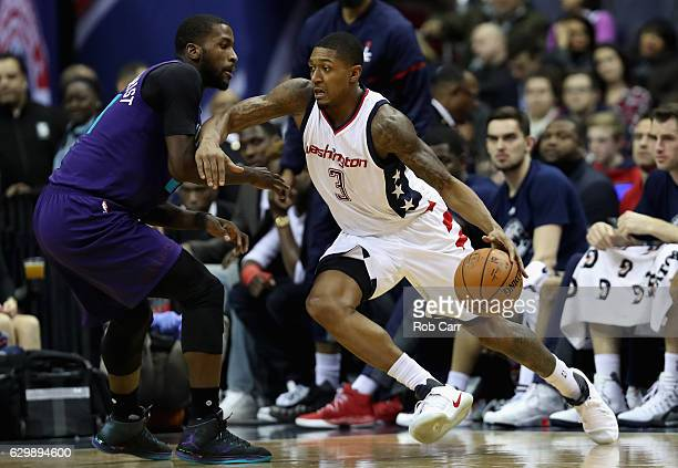 Bradley Beal of the Washington Wizards drives against Michael KiddGilchrist of the Charlotte Hornets in the first half at Verizon Center on December...