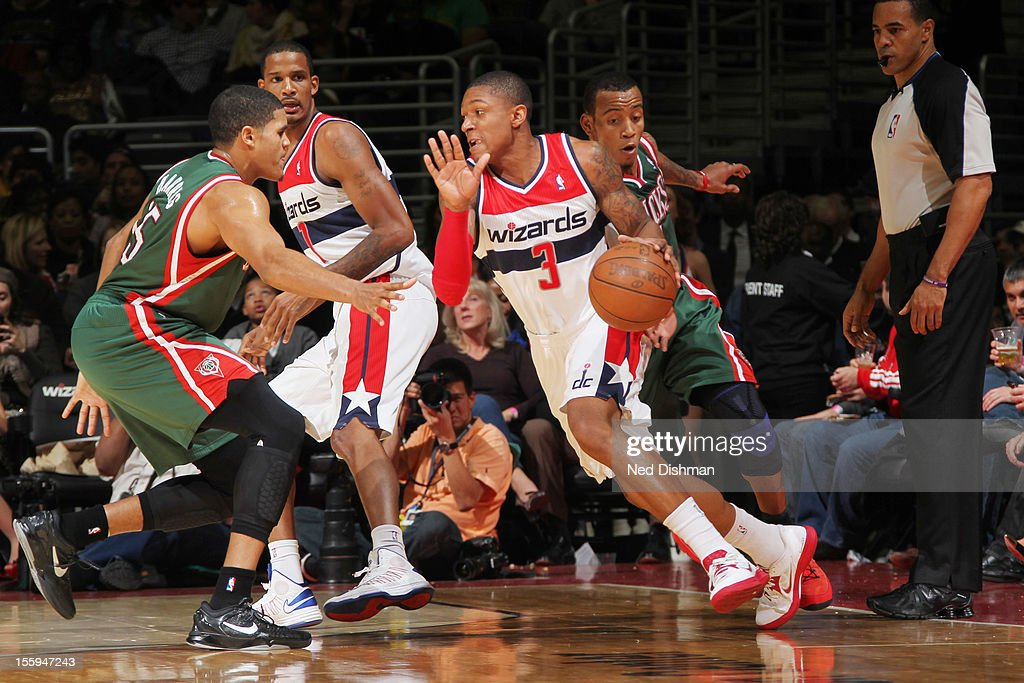 <a gi-track='captionPersonalityLinkClicked' href=/galleries/search?phrase=Bradley+Beal&family=editorial&specificpeople=7640439 ng-click='$event.stopPropagation()'>Bradley Beal</a> #3 of the Washington Wizards drives against <a gi-track='captionPersonalityLinkClicked' href=/galleries/search?phrase=Tobias+Harris&family=editorial&specificpeople=6902922 ng-click='$event.stopPropagation()'>Tobias Harris</a> #15 of the Milwaukee Bucks during the game at the Verizon Center on November 9, 2012 in Washington, DC.