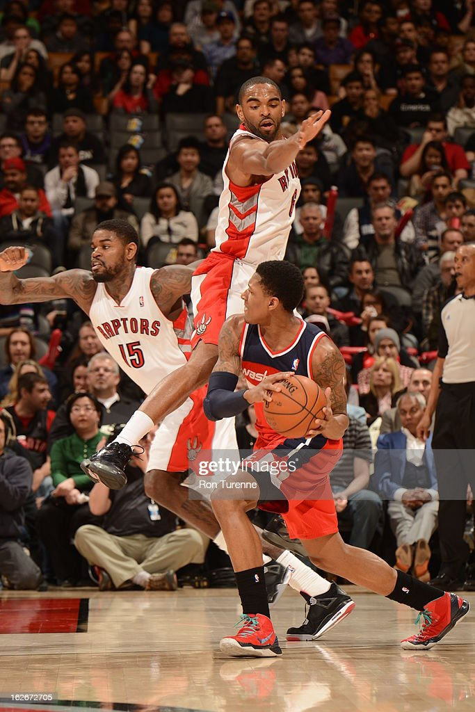 <a gi-track='captionPersonalityLinkClicked' href=/galleries/search?phrase=Bradley+Beal&family=editorial&specificpeople=7640439 ng-click='$event.stopPropagation()'>Bradley Beal</a> #3 of the Washington Wizards drives as <a gi-track='captionPersonalityLinkClicked' href=/galleries/search?phrase=Alan+Anderson&family=editorial&specificpeople=3945355 ng-click='$event.stopPropagation()'>Alan Anderson</a> #6 of the Toronto Raptors defends during the game between the Toronto Raptors and the Washington Wizards during the game on February 25, 2013 at the Air Canada Centre in Toronto, Ontario, Canada.
