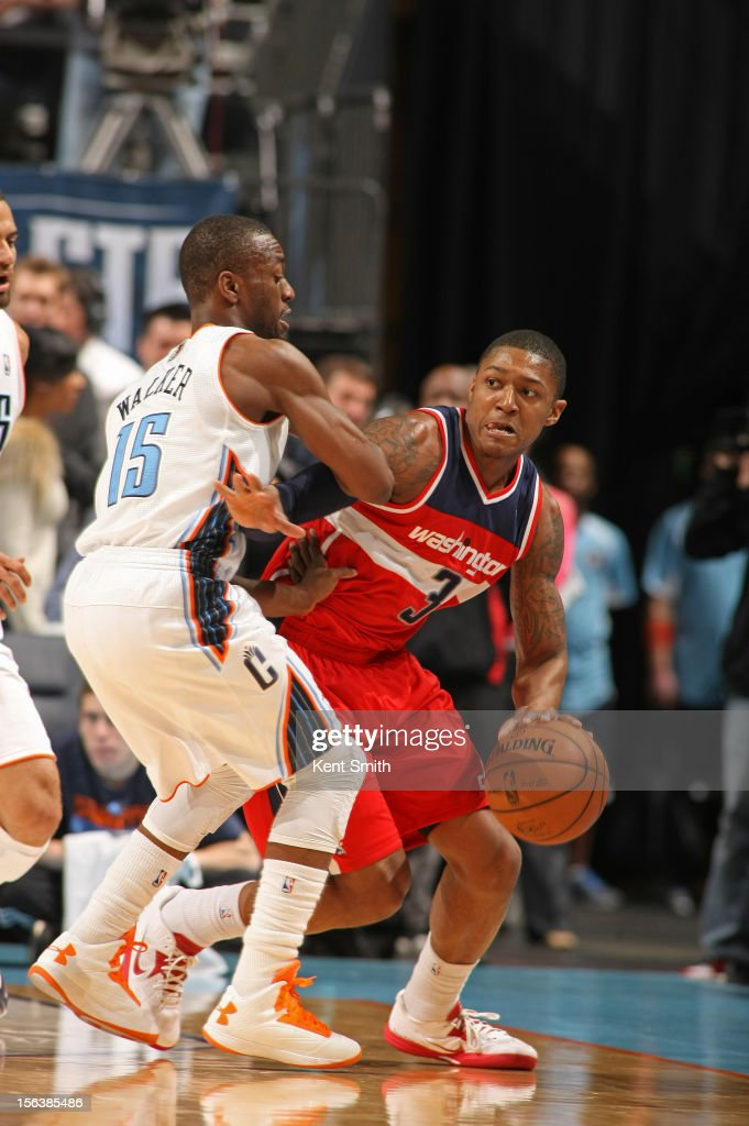<a gi-track='captionPersonalityLinkClicked' href=/galleries/search?phrase=Bradley+Beal&family=editorial&specificpeople=7640439 ng-click='$event.stopPropagation()'>Bradley Beal</a> #3 of the Washington Wizards drives to the basket against <a gi-track='captionPersonalityLinkClicked' href=/galleries/search?phrase=Kemba+Walker&family=editorial&specificpeople=5042442 ng-click='$event.stopPropagation()'>Kemba Walker</a> #15 of the Charlotte Bobcats at the Time Warner Cable Arena on November 13, 2012 in Charlotte, North Carolina.