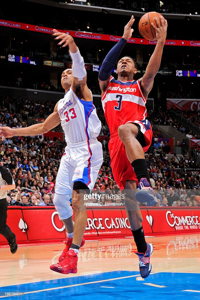 Bradley Beal #3 of the Washington Wizards drives to the basket against Grant Hill #33 of the Los Angeles Clippers at Staples Center on January 19, 2013 in Los Angeles, California.
