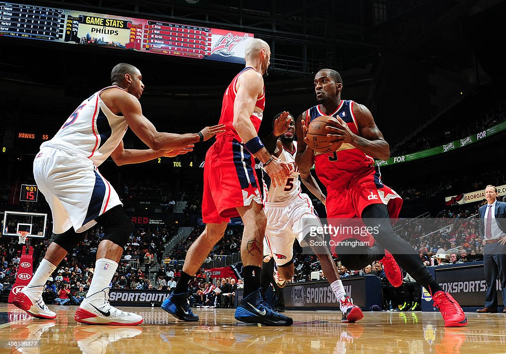 <a gi-track='captionPersonalityLinkClicked' href=/galleries/search?phrase=Bradley+Beal&family=editorial&specificpeople=7640439 ng-click='$event.stopPropagation()'>Bradley Beal</a> #3 of the Washington Wizards drives to the basket against the Atlanta Hawks on December 13, 2013 at Philips Arena in Atlanta, Georgia.