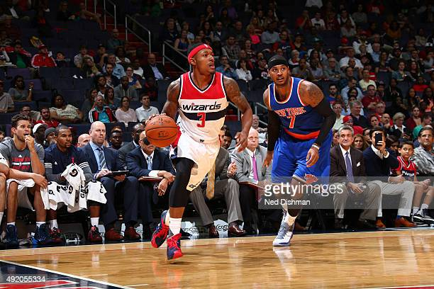 Bradley Beal of the Washington Wizards drives to the basket against Carmelo Anthony of the New York Knicks during a preseason game on October 9 2015...
