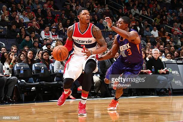 Bradley Beal of the Washington Wizards drives to the basket against Brandon Knight of the Phoenix Suns on December 4 2015 at Verizon Center in...