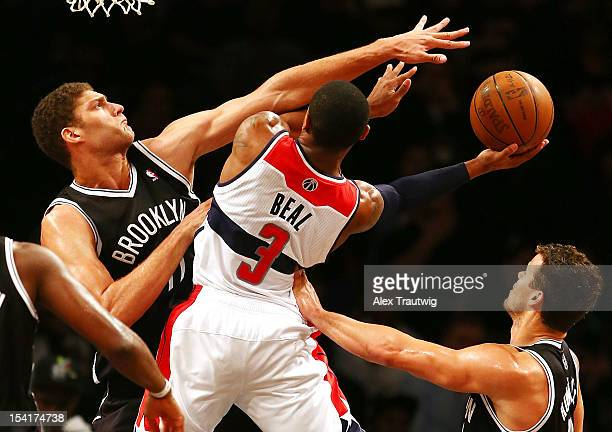 Bradley Beal of the Washington Wizards drives to the basket as Brook Lopez of the Brooklyn Nets defends during a preseason game at the Barclays...