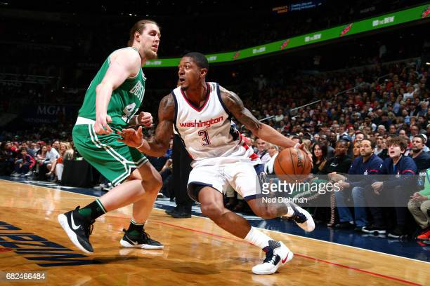 Bradley Beal of the Washington Wizards drives to the basket during the game against the Boston Celtics during Game Six of the Eastern Conference...