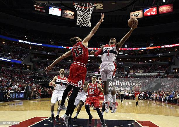 Bradley Beal of the Washington Wizards drives to the basket over Joakim Noah of the Chicago Bulls in Game Four of the Eastern Conference...