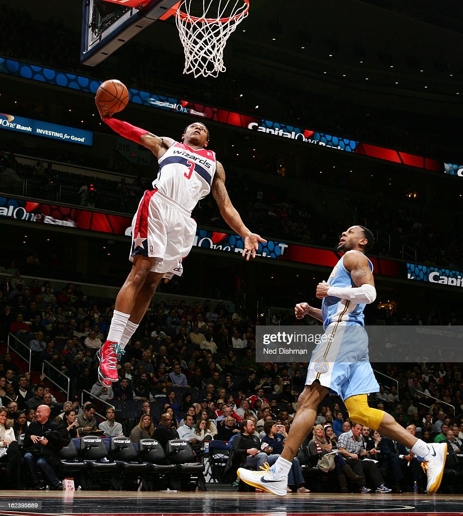 <a gi-track='captionPersonalityLinkClicked' href=/galleries/search?phrase=Bradley+Beal&family=editorial&specificpeople=7640439 ng-click='$event.stopPropagation()'>Bradley Beal</a> #3 of the Washington Wizards dunks against <a gi-track='captionPersonalityLinkClicked' href=/galleries/search?phrase=Andre+Iguodala&family=editorial&specificpeople=201980 ng-click='$event.stopPropagation()'>Andre Iguodala</a> #9 of the Denver Nuggets during the game at the Verizon Center on February 22, 2013 in Washington, DC.