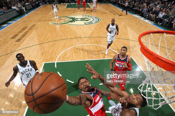 Bradley Beal of the Washington Wizards dunks against Giannis Antetokounmpo of the Milwaukee Bucks on November 20 2017 at the BMO Harris Bradley...