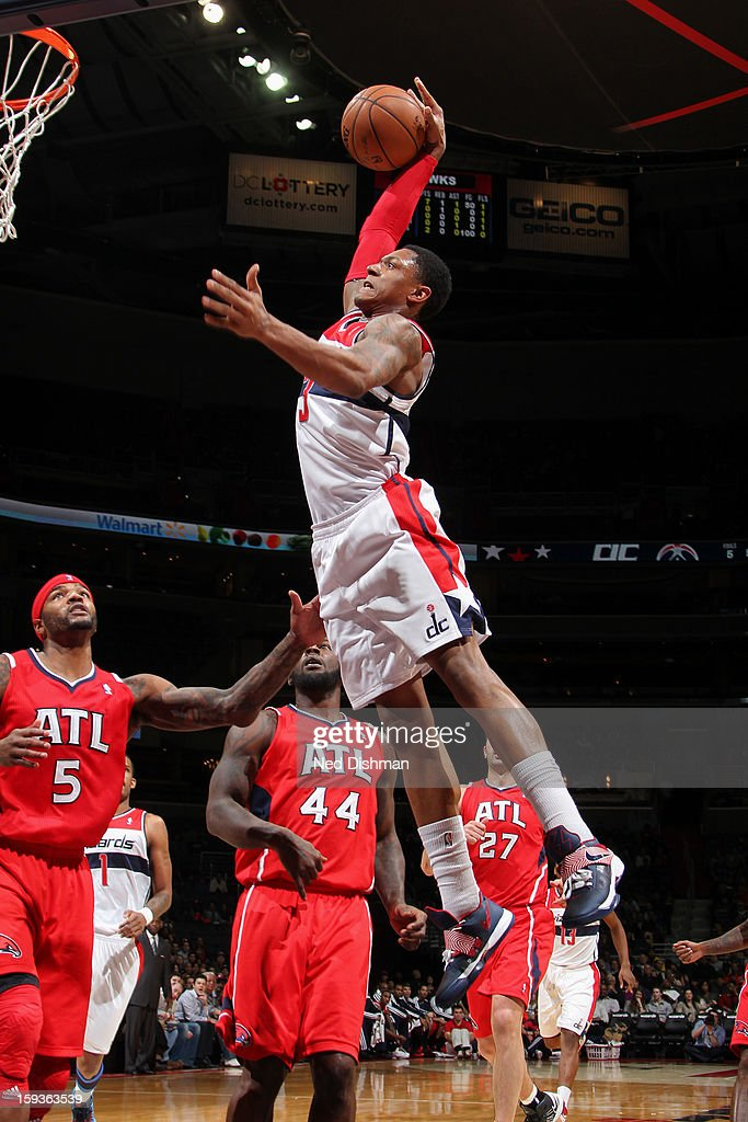 Bradley Beal #3 of the Washington Wizards dunks against Josh Smith #5 of the Atlanta Hawks during the game at the Verizon Center on January 12, 2013 in Washington, DC.