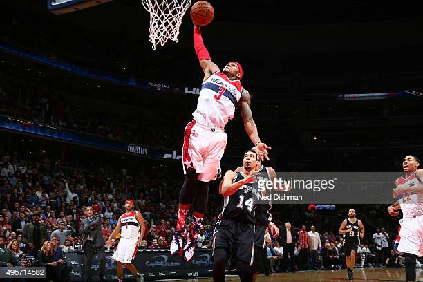 Bradley Beal of the Washington Wizards dunks against San Antonio Spurs during the game on November 4 2015 at Verizon Center in Washington DC NOTE TO...